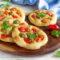 Pizzette con olive e pomodorini