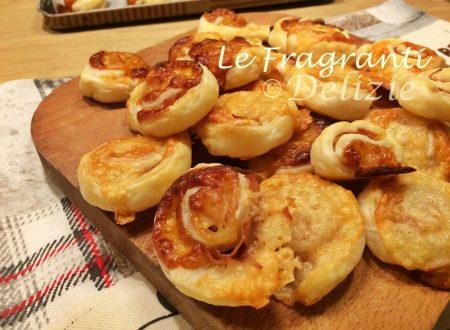Girelle di sfoglia con formaggio e mortadella