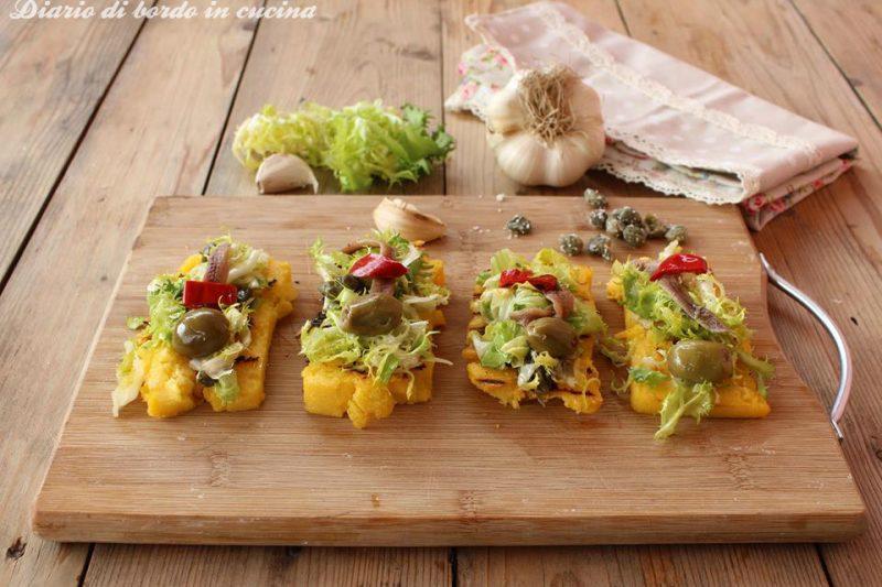 Crostini di polenta con scarola e alici