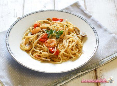Spaghetti con gamberi e funghi