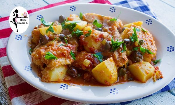 Baccalà al pomodoro patate e olive verdi alla messinese