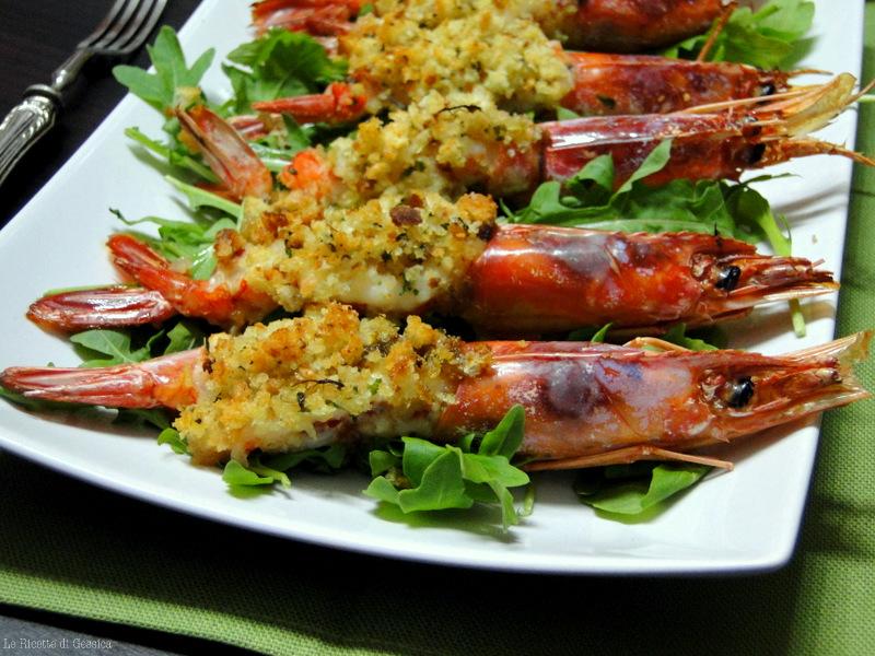 Gamberoni gratinati al forno ricetta con e senza bimby for Spiedini di pesce gratinati