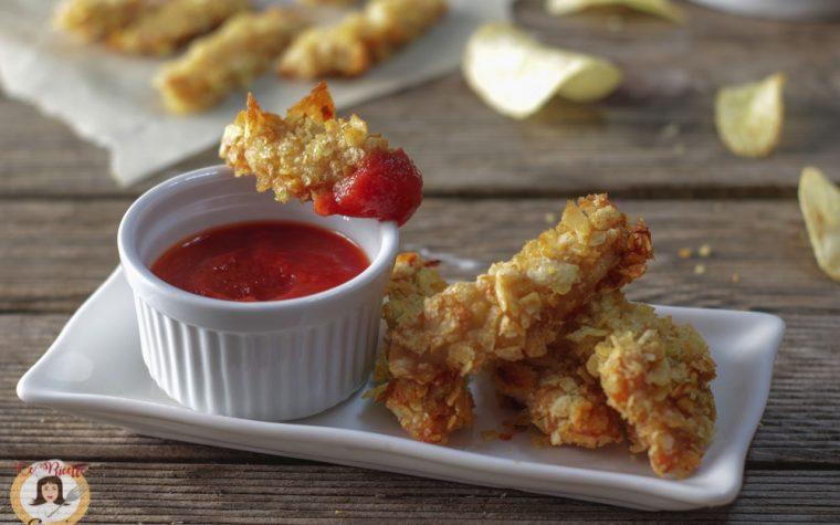 Pollo impanato nelle patatine – Bastoncini croccanti