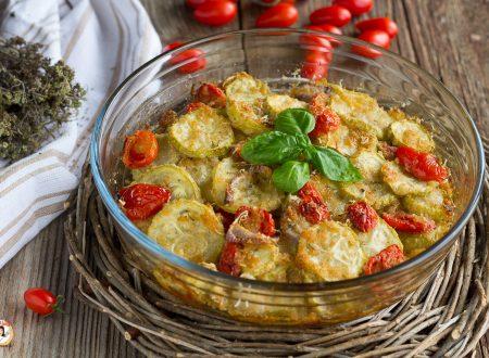 Zucchine gratinate con cipolle e pomodori – Contorno con un ingrediente speciale