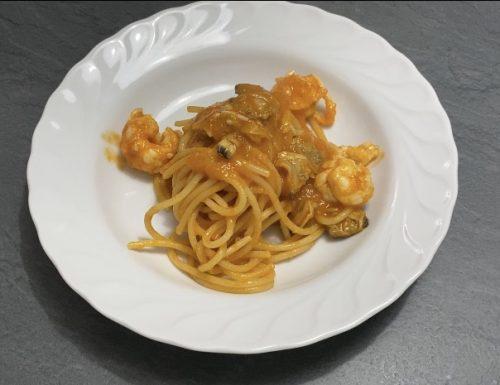 Spaghetti risottati con vongole e scampi