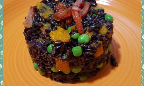 Tortino di riso venere con zucca, piselli e salame calabrese
