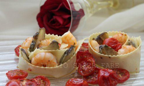 Rose di pasta con carciofi gamberetti e pomodorini confit
