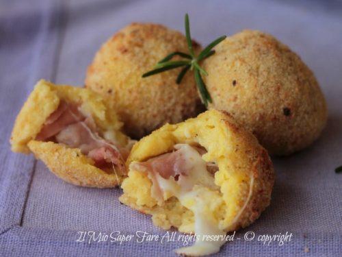 Pallotte di patate al forno ripiene di prosciutto e formaggio
