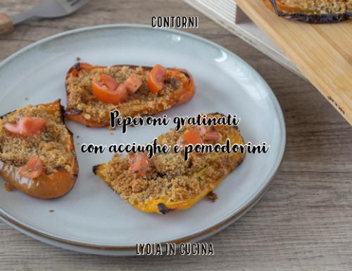 Peperoni gratinati con acciughe e pomodorini