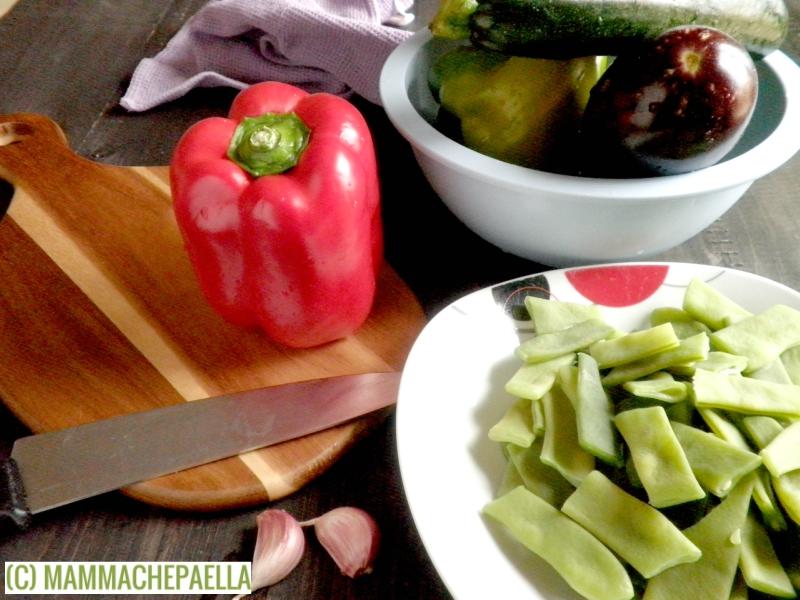 Preparando paella di verdure
