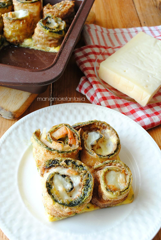 rotolini di zucchine al formaggio su frittatina alla menta