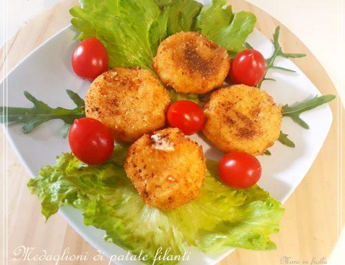 Medaglioni di patate filanti