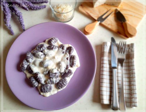 Gnocchi viola con toma d'Alba e grana padano