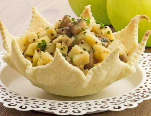 Insalata di patate, mele e aringhe affumicate