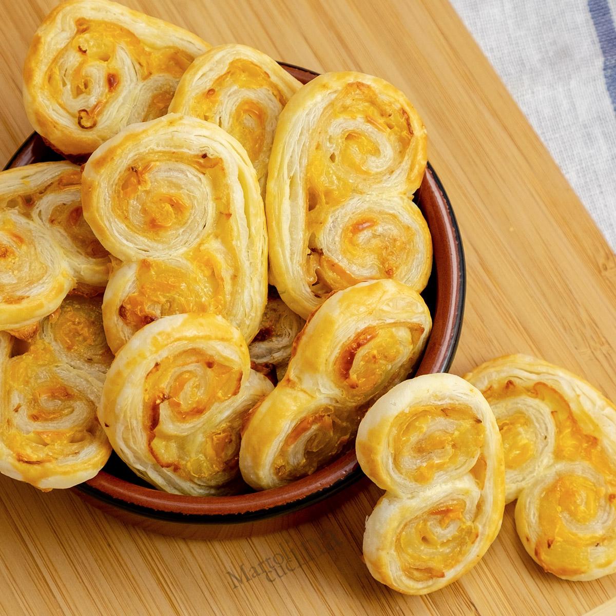 Chiocciole di sfoglia al prosciutto e formaggio