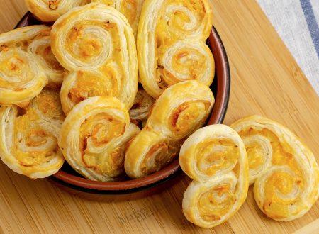 Chiocciole di sfoglia al prosciutto e formaggio, ricetta facile