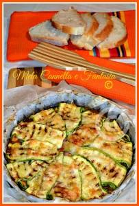 Parmigiana di zucchine con speck, provola affumicata, pomodoro e mozzarella