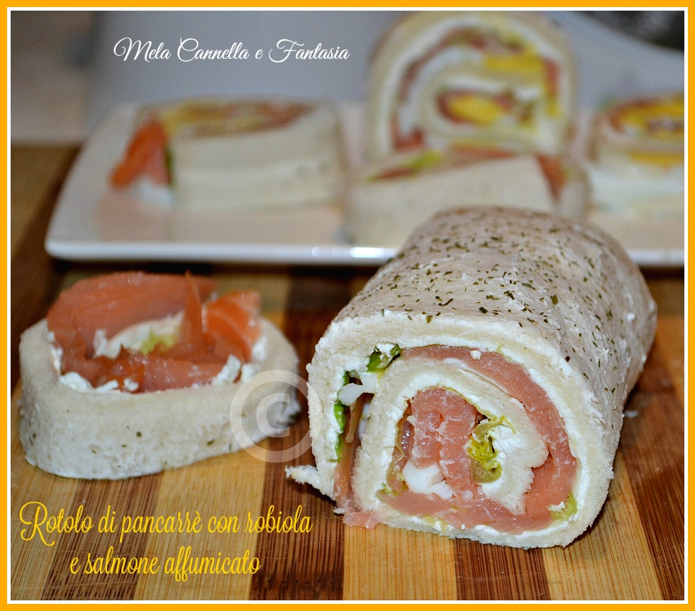 Rotolo di pancarré con robiola, salmone, insalata e uovo sodo