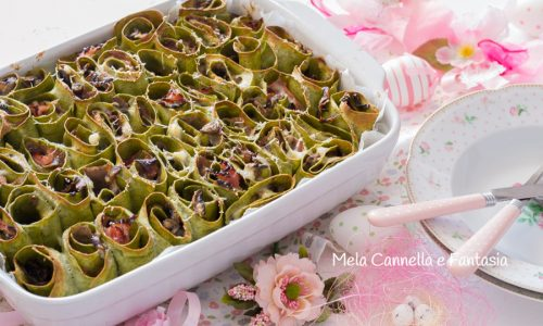Rotoli di lasagne verdi con funghi e prosciutto cotto