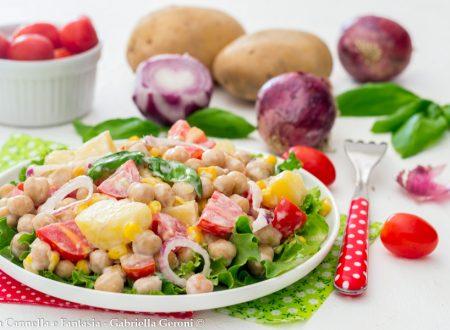 Insalata fredda di ceci con patate pomodorini e cipolla rossa