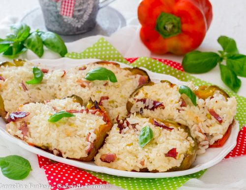 Peperoni farciti con risotto allo speck e mozzarella
