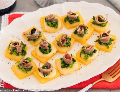 Crostini di polenta con formaggio cime di rapa e acciughe