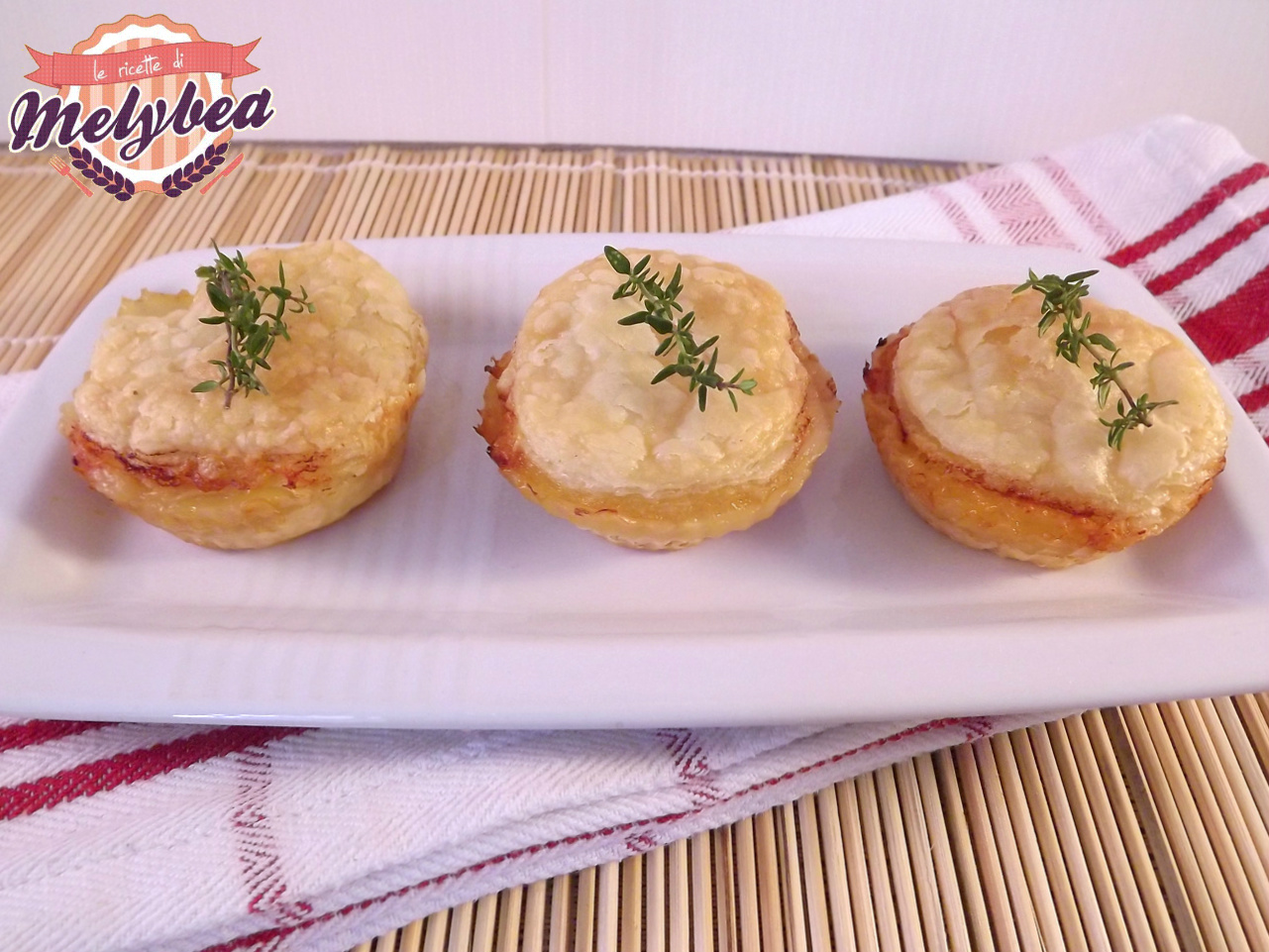 fagottini di sfoglia con prosciutto e formaggio