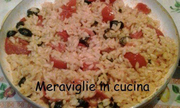 Risotto con ciliegino e olive