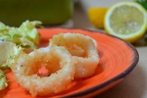 Anelli di calamari gratinati, ricetta al forno
