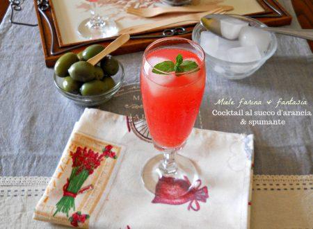 Cocktail al succo d'arancia e prosecco
