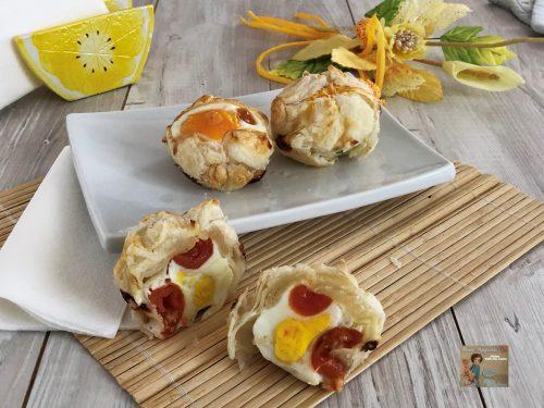 Fagottini di sfoglia con uova e pomodorini