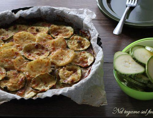Patate e zucchine in teglia con bacon e mozzarella