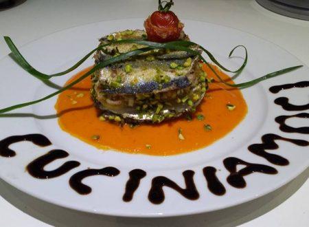 Gateau di sardine e patate con pistacchi di Bronte su letto di crema di peperoni