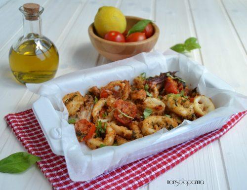 Anelli di calamari e pomodorini gratinati