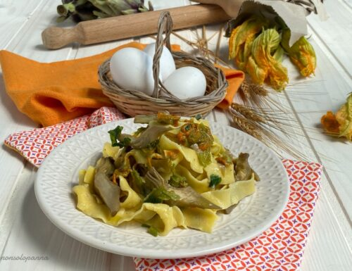Tagliatelle all'uovo con carciofi e fiori di zucca