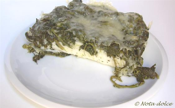 Polenta bianca con spinaci e provola ricetta