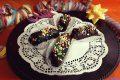 Cannoli di Carnevale alla marmellata ricoperti di cioccolato
