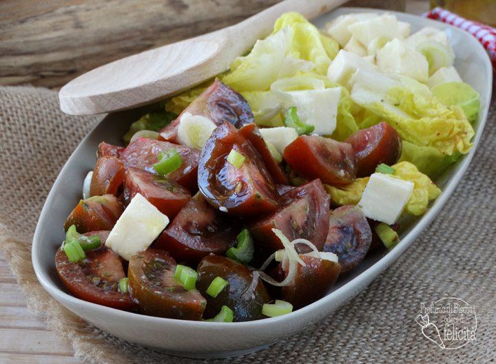 pomodoro camone in insalata con mozzarella e cipollotto