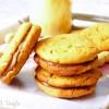 biscotti sandwich alle arachidi e cioccolato