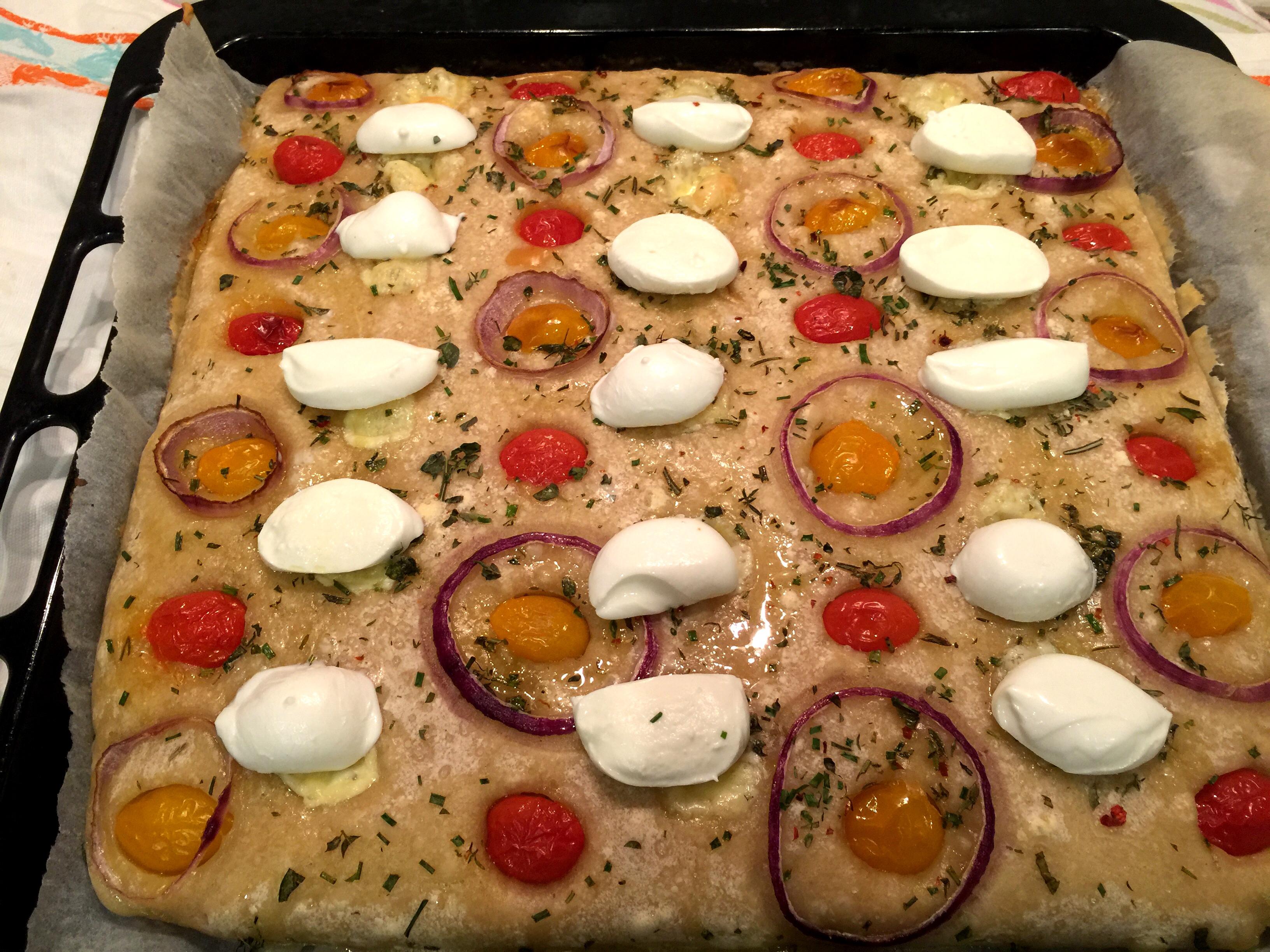 Pane pizza condito