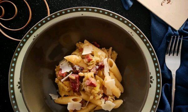 Pennette con speck verza pinoli e parmigiano