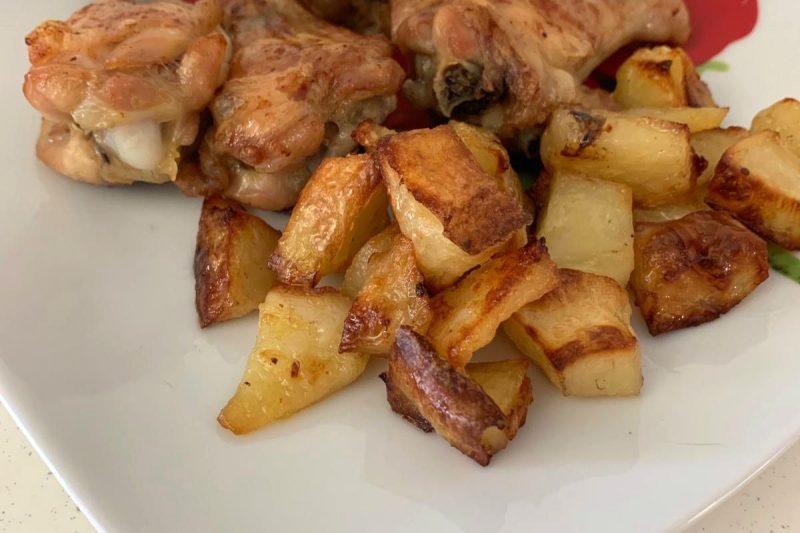 Fusi di pollo con patate al forno