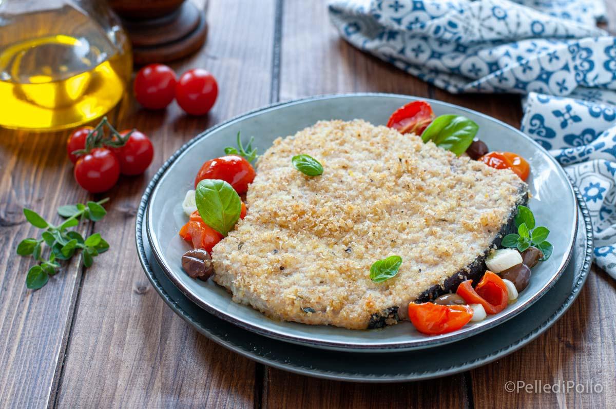 pesce spada al forno con pomodorini e olive