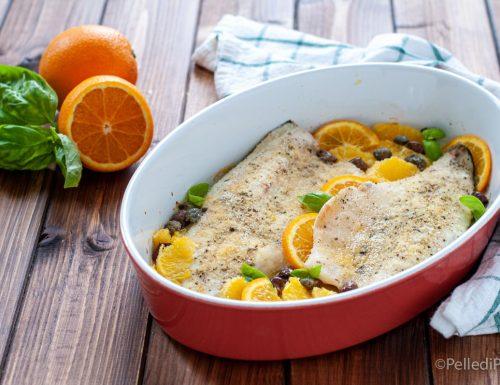 Filetti di branzino al forno con arancia e olive