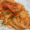 Spaghetti quadrati al sugo di gamberoni.