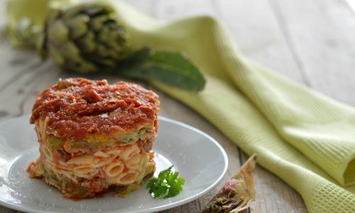 Parmigiana di carciofi con la pasta