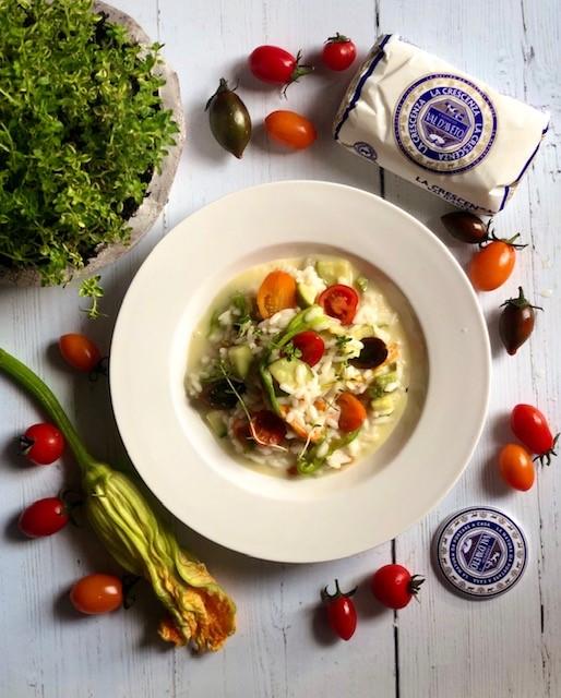 Risotto cremoso alle zucchine e pomodorini