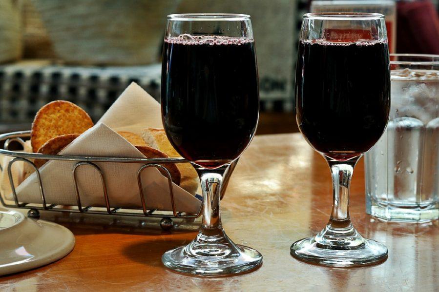 quanto pesa un litro di vino rosso in grammi