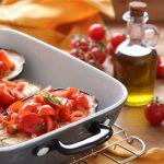 Melanzane al forno con aglio e pomodorini