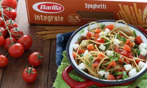 Spaghetti integrali con pomodorini rucola e feta